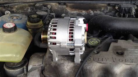 How to replace an Alternator on a 2000 Ford Focus - YouTube