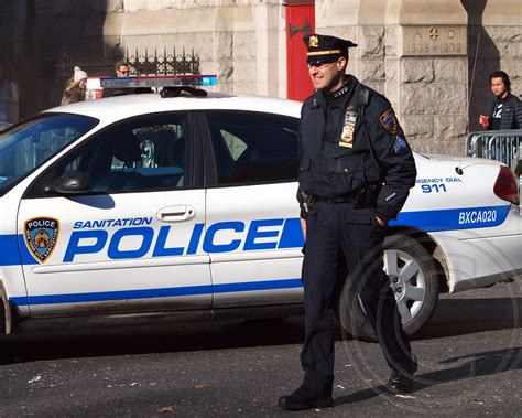NYPD Police Officer and NYC Sanitation Police Car, 2012 Ma